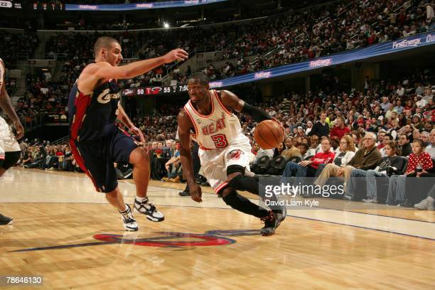 Dwyane Wade of the Miami Heat drives to the basket against Sasha Pavlovic of the Cleveland Cavaliers on December 25, 2007 at The Quicken Loans Arena...
