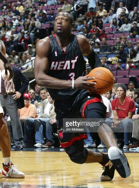 Dwyane Wade of the Miami Heat drives to the basket against the New Jersey Nets during their game on November 10, 2006 at Continental Airlines Arena...