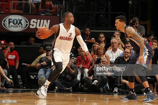Dwyane Wade of the Miami Heat drives to the basket against the Memphis Grizzlies during the game on December 13 2015 at American Airlines Arena in...