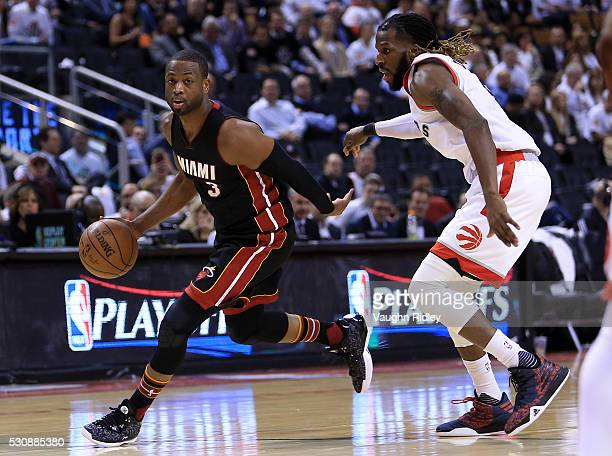 Dwyane Wade of the Miami Heat drives to the basket as DeMarre Carroll of the Toronto Raptors defends in the second half of Game Five of the Eastern...