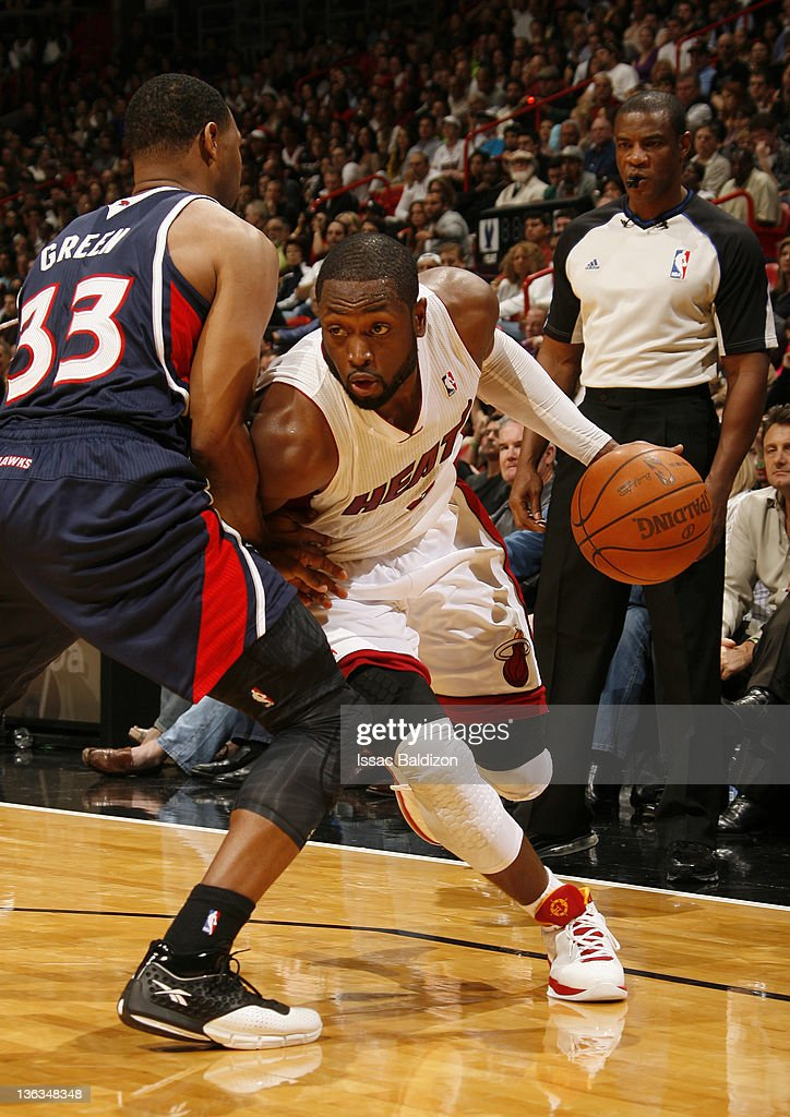 Dwyane Wade #3 of the Miami Heat drives to the basket during the fourth quarter against Willie Green #33 of the Atlanta Hawks on January 2, 2012 at American Airlines Arena in Miami, Florida.