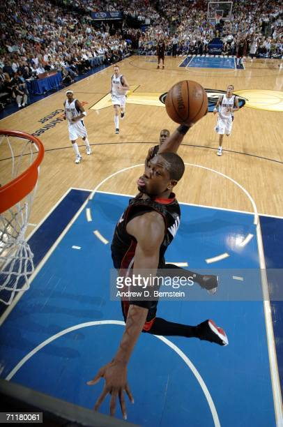 Dwyane Wade of the Miami Heat drives to the basket for a dunk against the Dallas Mavericks during Game Two of the 2006 NBA Finals June 11 2006 at...