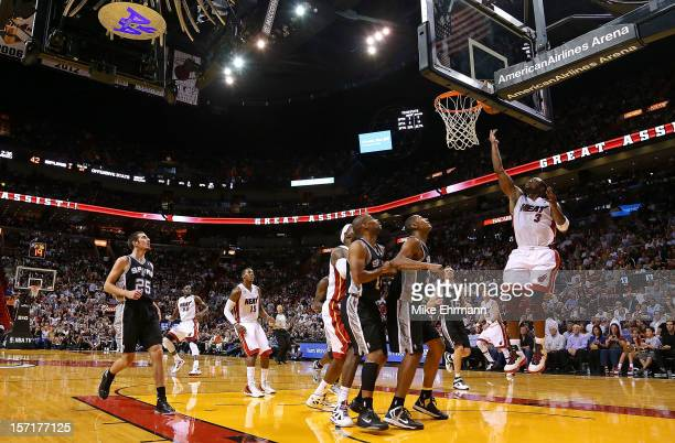 Dwyane Wade of the Miami Heat drives to the rim during a game against the San Antonio Spurs at American Airlines Arena on November 29 2012 in Miami...
