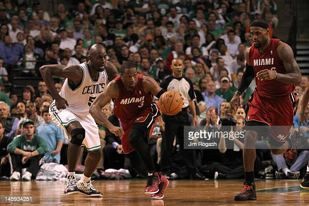 Dwyane Wade of the Miami Heat drives up court with teammate LeBron James against Kevin Garnett of the Boston Celtics in Game Six of the Eastern...
