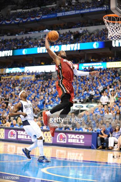 Dwyane Wade of the Miami Heat dunks against Jason Terry of the Dallas Mavericks during Game Three of the 2011 NBA Finals on June 5 2011 at the...
