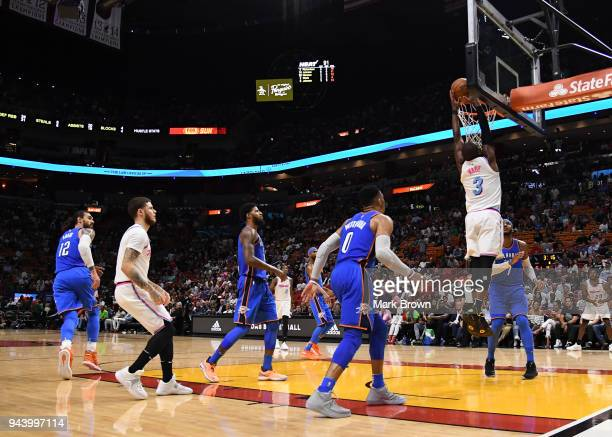 Dwyane Wade of the Miami Heat dunks during the game against the Oklahoma City Thunder at American Airlines Arena on April 9 2018 in Miami Florida...