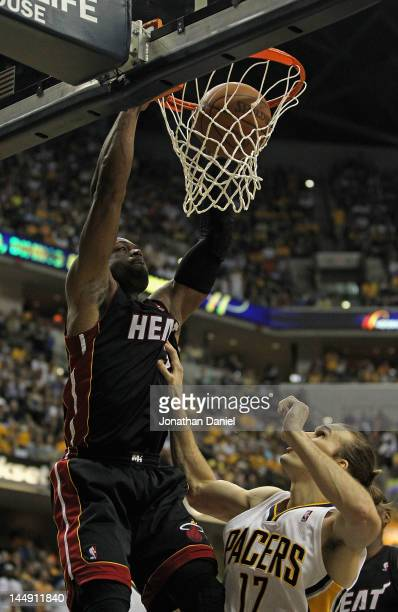 Dwyane Wade of the Miami Heat dunks over Lou Amundson of the Indiana Pacers in Game Four of the Eastern Conference Semifinals in the 2012 NBA...