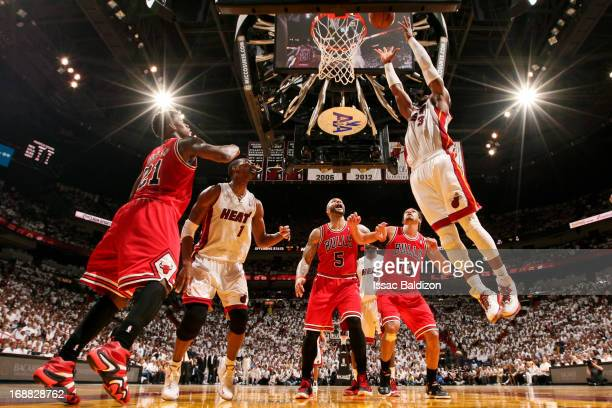 Dwyane Wade of the Miami Heat dunks the ball after catching an offensive rebound against the Chicago Bulls in Game Five of the Eastern Conference...