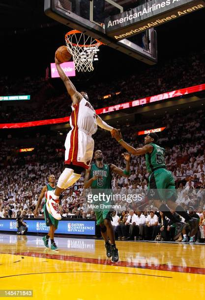 Dwyane Wade of the Miami Heat dunks the ball against Kevin Garnett and Keyon Dooling of the Boston Celtics in Game Two of the Eastern Conference...