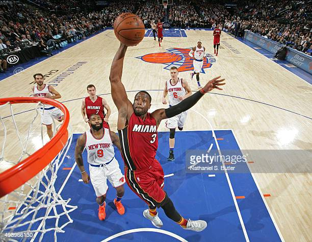 Dwyane Wade of the Miami Heat dunks the ball against the New York Knicks on November 27, 2015 at Madison Square Garden in New York City, New York....