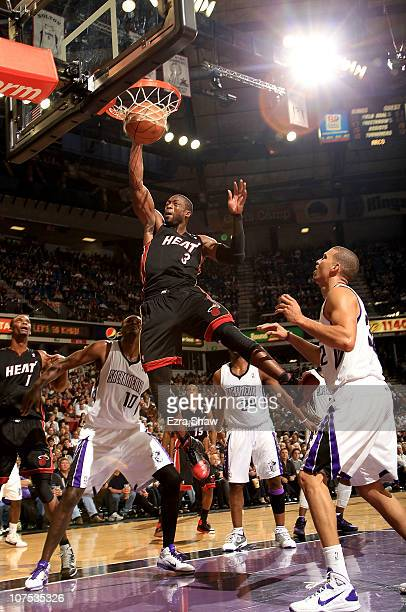 Dwyane Wade of the Miami Heat dunks the ball against the Sacramento Kings at ARCO Arena on December 11 2010 in Sacramento California NOTE TO USER...