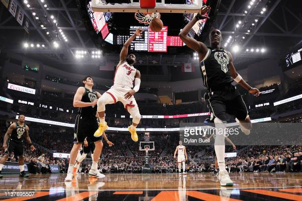 Dwyane Wade of the Miami Heat dunks the ball past Ersan Ilyasova and Tony Snell of the Milwaukee Bucks in the second quarter at the Fiserv Forum on...