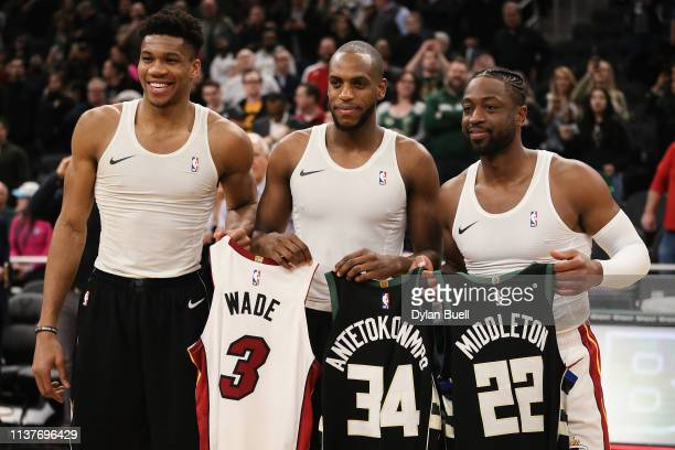 Dwyane Wade of the Miami Heat exchanges jerseys with Giannis Antetokounmpo and Khris Middleton of the Milwaukee Bucks after the Bucks beat the Heat...