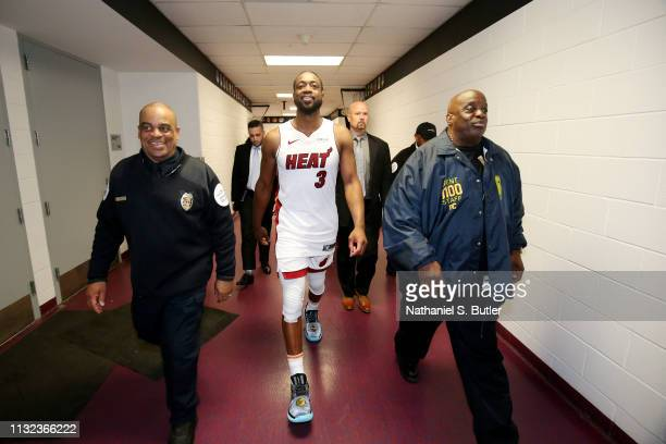 Dwyane Wade of the Miami Heat exits the floor after the game against the Washington Wizards on March 23 2019 at Capital One Arena in Washington DC...