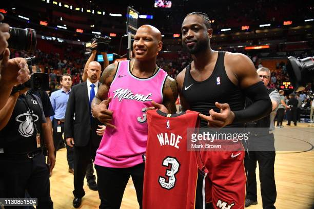 Dwyane Wade of the Miami Heat gives a jersey to Pittsburgh Steeler Ryan Shazier after the game between the Miami Heat and the Milwaukee Bucks at...