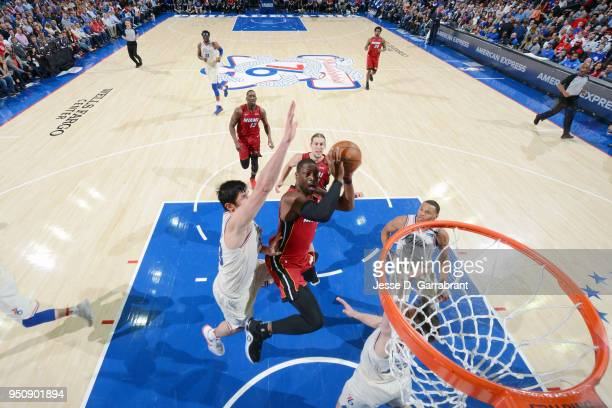 Dwyane Wade of the Miami Heat goes to the basket against the Philadelphia 76ers in Game Five of Round One of the 2018 NBA Playoffs on April 24 2018...