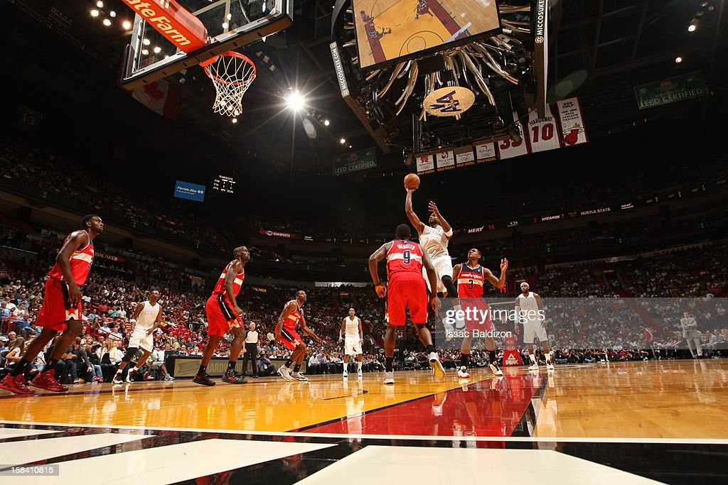 Dwyane Wade #3 of the Miami Heat goes to the basket during a game between the Washington Wizards and the Miami Heat on December 15, 2012 at American Airlines Arena in Miami, Florida.