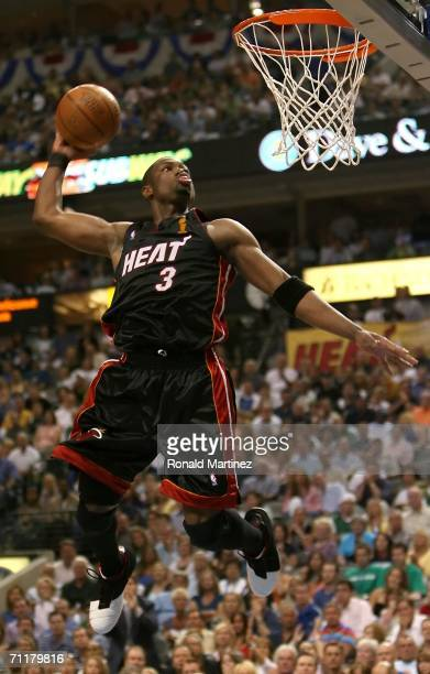 Dwyane Wade of the Miami Heat goes to the basket for a slam dunk against the Dallas Mavericks in the second quarter of game two of the 2006 NBA...