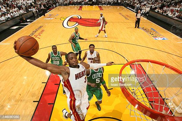 Dwyane Wade of the Miami Heat goes to the basket in Game Seven of the Eastern Conference Finals between the Miami Heat and the Boston Celtics during...