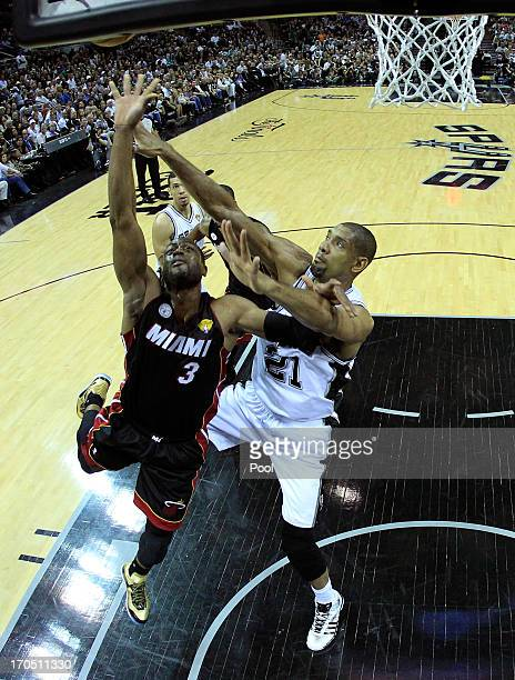Dwyane Wade of the Miami Heat goes up for a shot against Tim Duncan of the San Antonio Spurs in the first half during Game Four of the 2013 NBA...