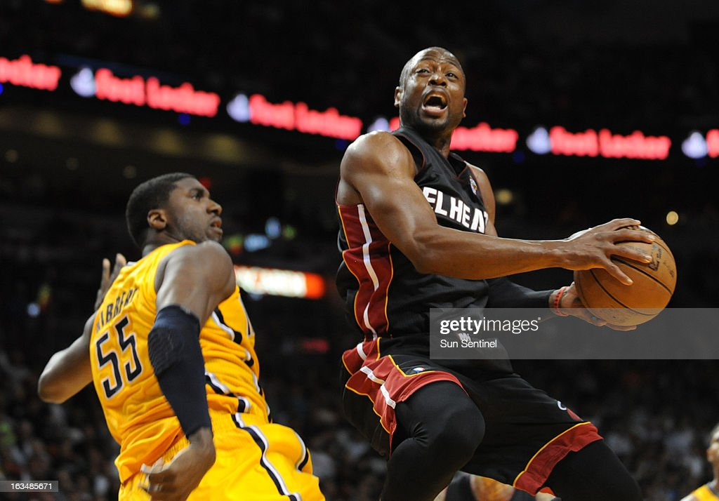 Dwyane Wade of the Miami Heat goes up for a shot in the fourth quarter against the Indiana Pacers at the AmericanAirlines Arena in Miami, Florida, Sunday, March 10, 2013.