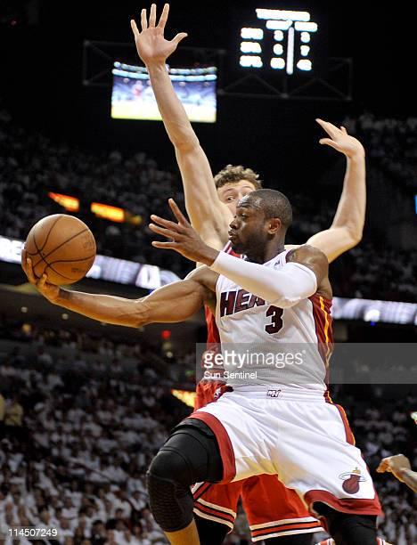 Dwyane Wade of the Miami Heat goes up for a shot over Omer Asik of the Chicago Bulls in the third quarter during Game 3 of the NBA Eastern Conference...