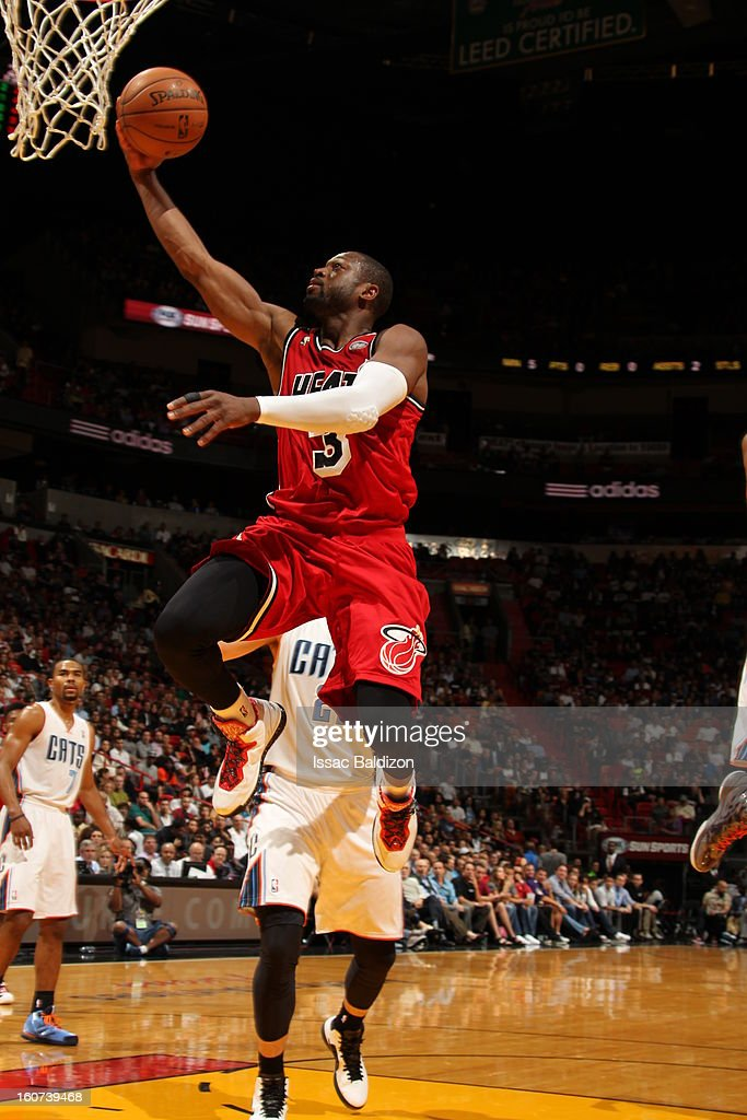 Dwyane Wade #3 of the Miami Heat goes up for the easy basket against the Charlotte Bobcats during a game on February 4, 2013 at American Airlines Arena in Miami, Florida.