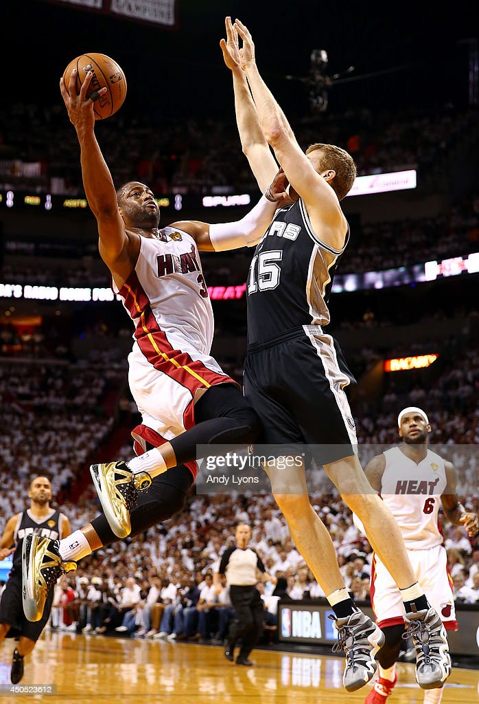 Dwyane Wade #3 of the Miami Heat goes up to the basket against Matt Bonner #15 of the San Antonio Spurs during Game Four of the 2014 NBA Finals at American Airlines Arena on June 12, 2014 in Miami, Florida.