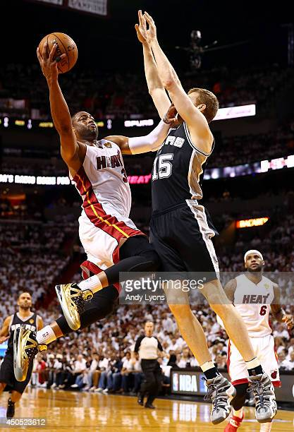 Dwyane Wade of the Miami Heat goes up to the basket against Matt Bonner of the San Antonio Spurs during Game Four of the 2014 NBA Finals at American...