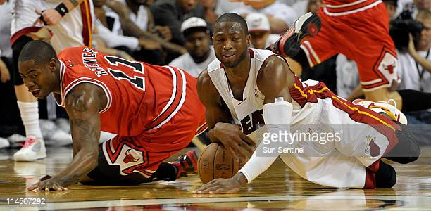 Dwyane Wade of the Miami Heat grabs a loose ball from Ronnie Brewer of the Chicago Bulls during Game 3 of the NBA Eastern Conference Finals at the...