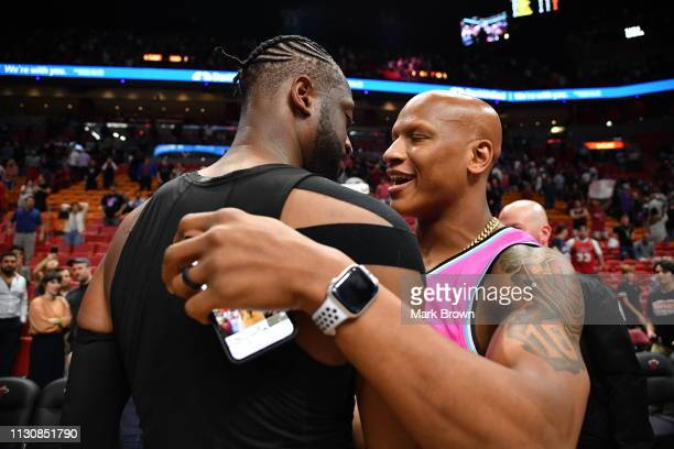 Dwyane Wade of the Miami Heat greets Pittsburgh Steeler Ryan Shazier after the game between the Miami Heat and the Milwaukee Bucks at American...