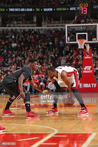 Dwyane Wade of the Miami Heat handles the ball against Jimmy Butler of the Chicago Bulls during the game on January 25 2015 at the United Center in...