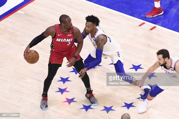 Dwyane Wade of the Miami Heat handles the ball against Robert Covington of the Philadelphia 76ers during game two of round one of the 2018 NBA...