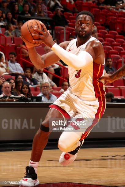 Dwyane Wade of the Miami Heat handles the ball against the Orlando Magic during a preseason game on October 8 2018 at American Airlines Arena in...