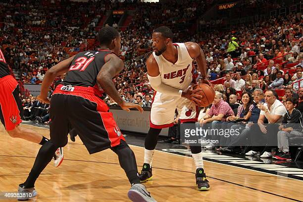 Dwyane Wade of the Miami Heat handles the ball against the Toronto Raptors on April 11 2015 at American Airlines Arena in Miami Florida NOTE TO USER...