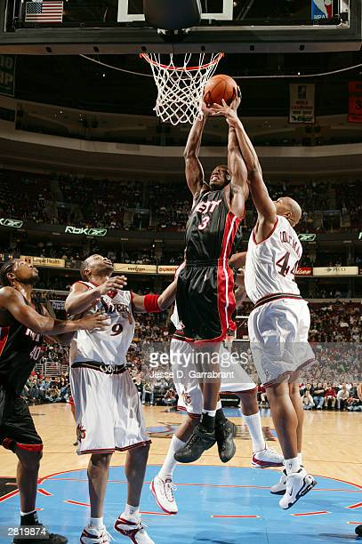 Dwyane Wade of the Miami Heat heads up for two against Derrick Coleman of the Philadelphia 76ers at the Wachovia Center on December 17 2003 in...