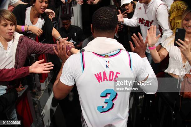 Dwyane Wade of the Miami Heat high fives fans after the game against the Milwaukee Bucks on February 9 2018 at American Airlines Arena in Miami...