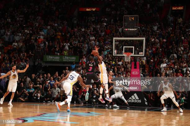 Dwyane Wade of the Miami Heat hits the game winning threepointer against the Golden State Warriors on February 27 2019 at American Airlines Arena in...