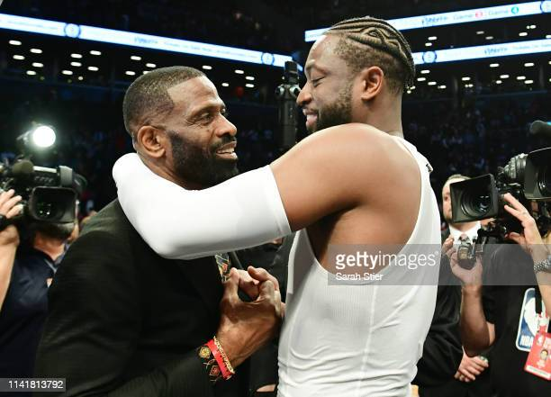 Dwyane Wade of the Miami Heat hugs his father Dwyane Wade Sr after the game against the Brooklyn Nets at Barclays Center on April 10 2019 in the...