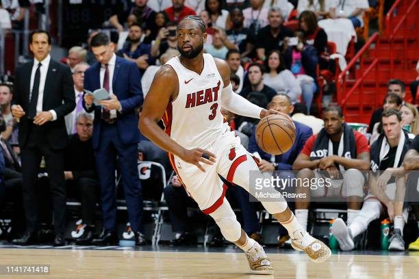 Dwyane Wade of the Miami Heat in action against the Philadelphia 76ers during the second half at American Airlines Arena on April 09, 2019 in Miami,...