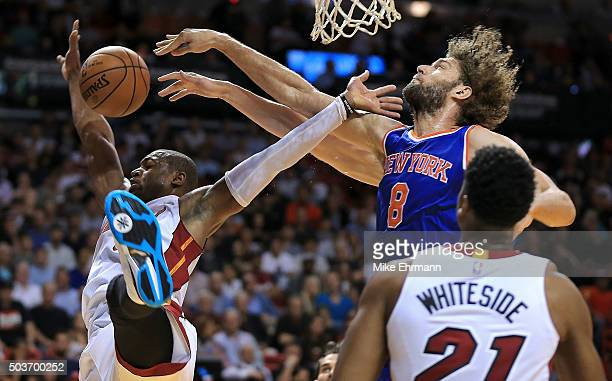 Dwyane Wade of the Miami Heat is blocked by Robin Lopez of the New York Knicks during a game at American Airlines Arena on January 6 2016 in Miami...