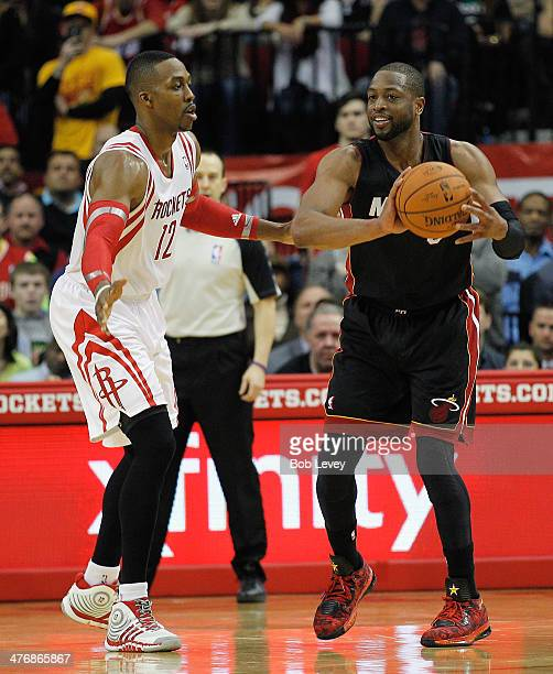 Dwyane Wade of the Miami Heat is defended by Dwight Howard of the Houston  Rockets at 8cc17884966e