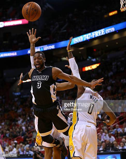 Dwyane Wade of the Miami Heat is fouled by CJ Miles of the Indiana Pacers during a game at American Airlines Arena on January 23 2015 in Miami...