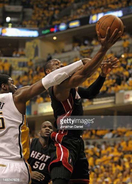 Dwyane Wade of the Miami Heat is fouled by Roy Hibbert of the Indiana Pacers in Game Six of the Eastern Conference Semifinals in the 2012 NBA...