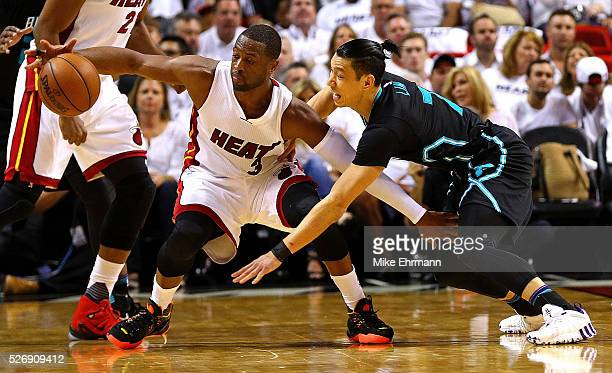 Dwyane Wade of the Miami Heat is guarded by Jeremy Lin of the Charlotte Hornets during Game Seven of the Eastern Conference Quarterfinals of the 2016...