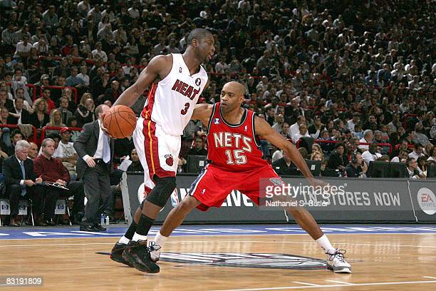 Dwyane Wade of the Miami Heat is guarded by Vince Carter of the New Jersey Nets during the NBA preseson game as part of the 2008 NBA Europe Live Tour...