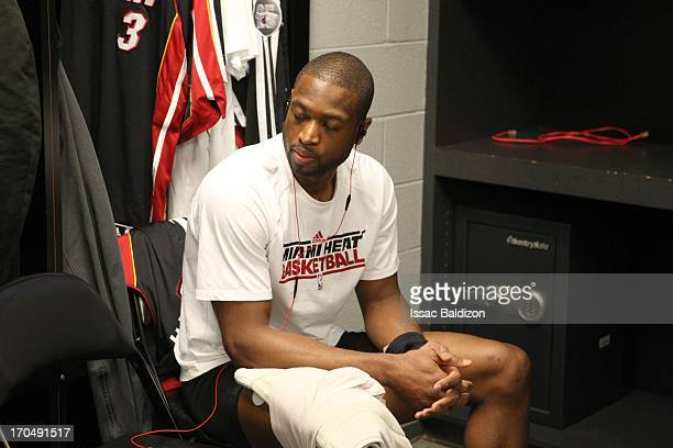 Dwyane Wade of the Miami Heat is seen in the locker room preparing for Game Four of the 2013 NBA Finals between the Miami Heat and the San Antonio...