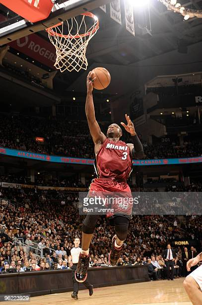 Dwyane Wade of the Miami Heat lays one in against the Toronto Raptors during a game on January 27 2010 at the Air Canada Centre in Toronto Ontario...