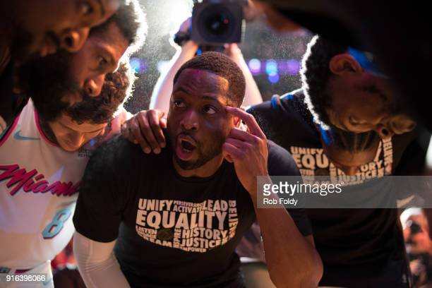 Dwyane Wade of the Miami Heat leads teammates in a huddle before the game against the Milwaukee Bucks at American Airlines Arena on February 9 2018...