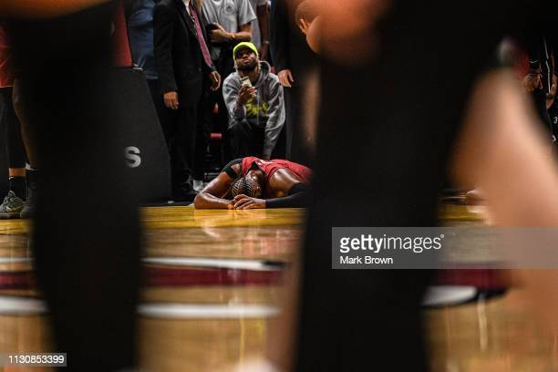 Dwyane Wade of the Miami Heat leaves the game after getting injured in the second half against the Milwaukee Bucks at American Airlines Arena on...